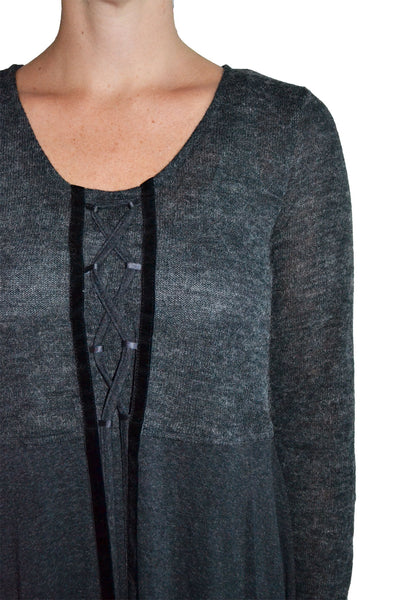 Detailed view of scoop neck knit top from Monoreno featuring strap front detailing.
