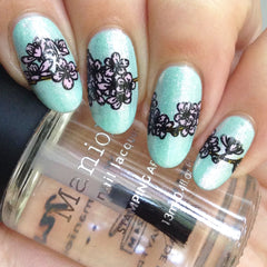 Manicure with flower design and Maniology nail lacquer