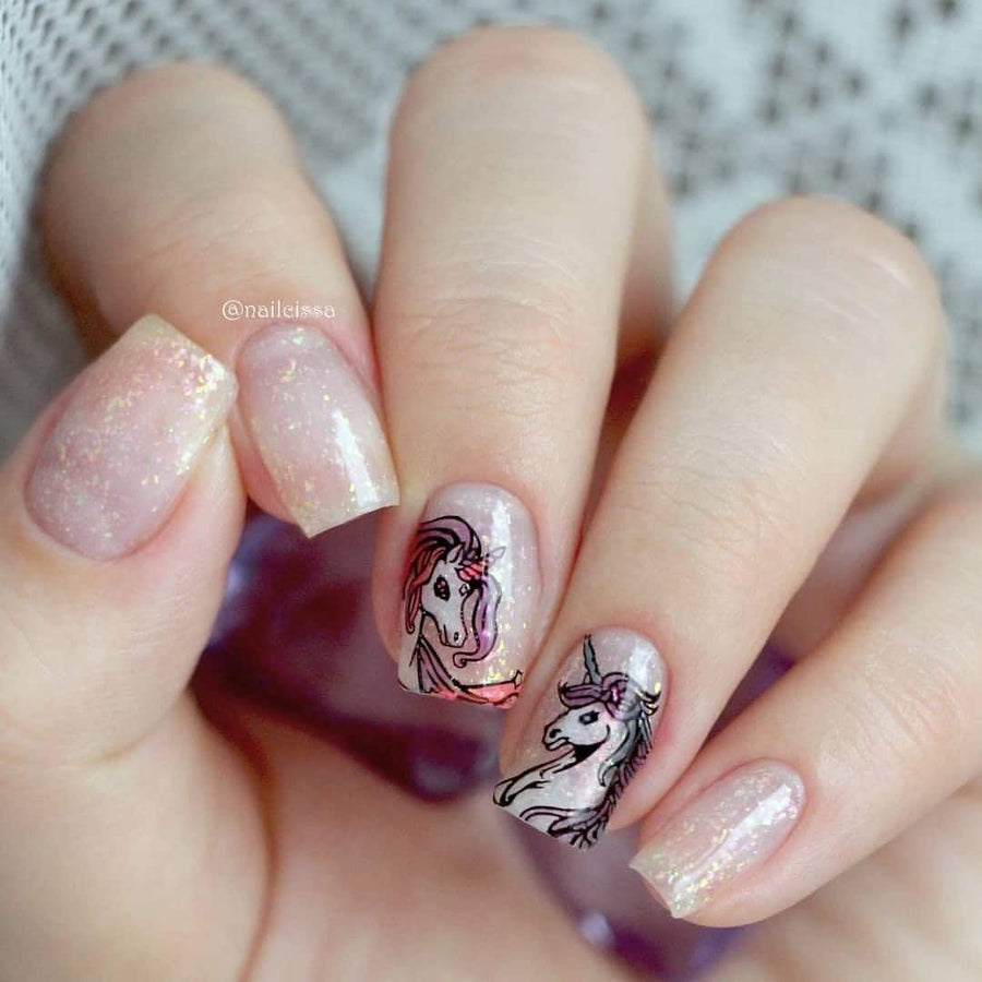 A manicured hand with unicorn design.