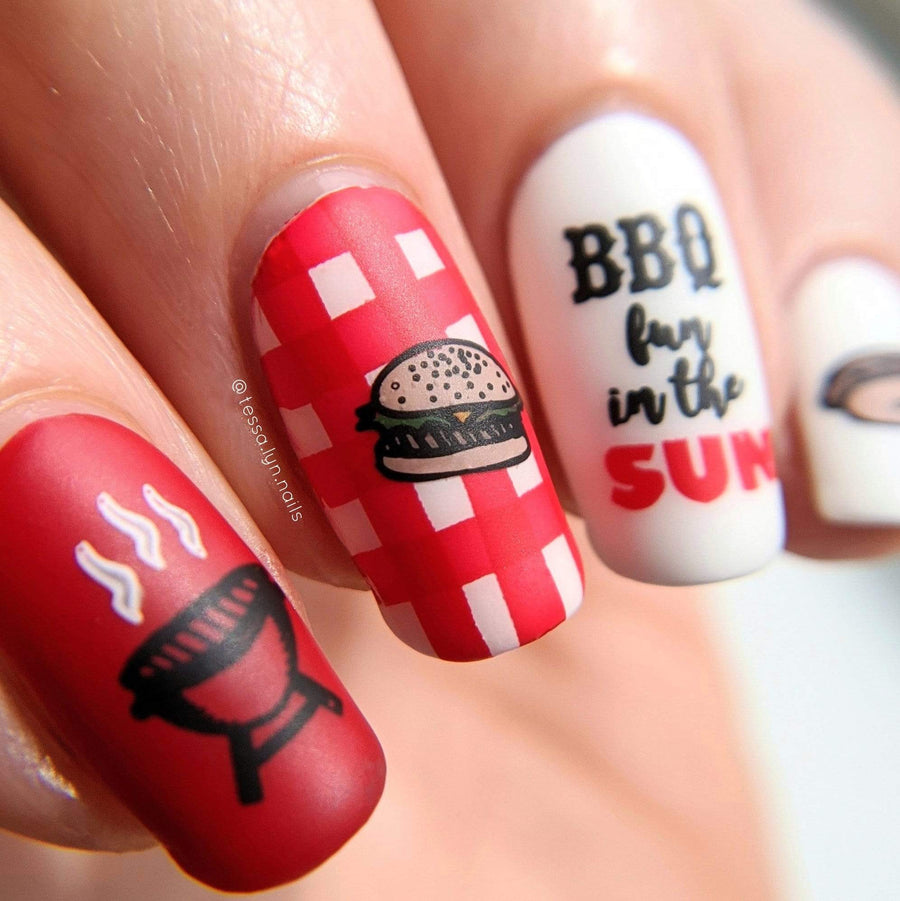 A manicured hand in red and white with burger and barbeque grill designs by Maniology Sweet Thing (m100).