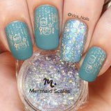 A manicured hand with Icy Blue Stamping Polish