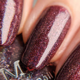 A close up of Maniology Moods holographic polish in Bossy