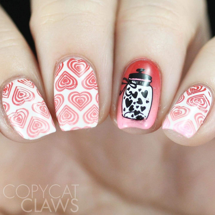 A manicured hand made with Galentine (B329) Metallic Red Stamping Polish by Maniology.