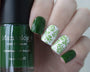 A manicured hand holding Sheer Green Stamping Polish from Rainbow Splash Collection: Garden Gnome (B275).