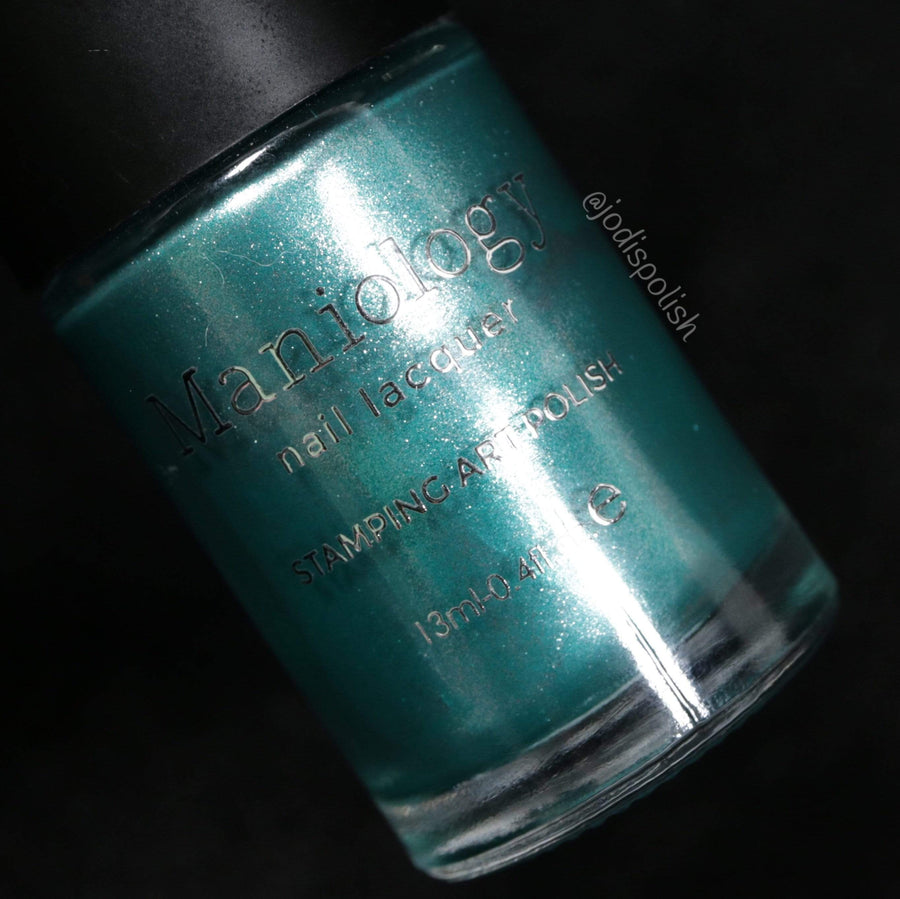 A Metallic Teal Stamping Polish with a touch of silver from Soiree All Day collection Sequins (B320).