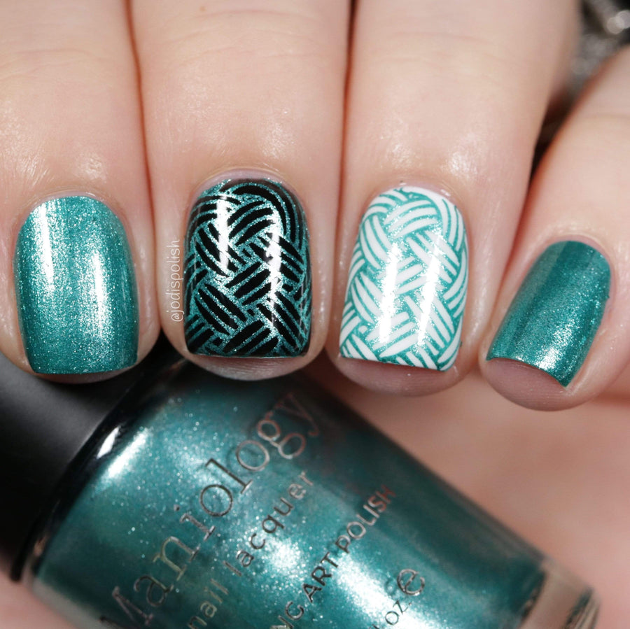 A manicured hand holding Metallic Teal Stamping Polish from Soiree All Day collection Sequins (B320).