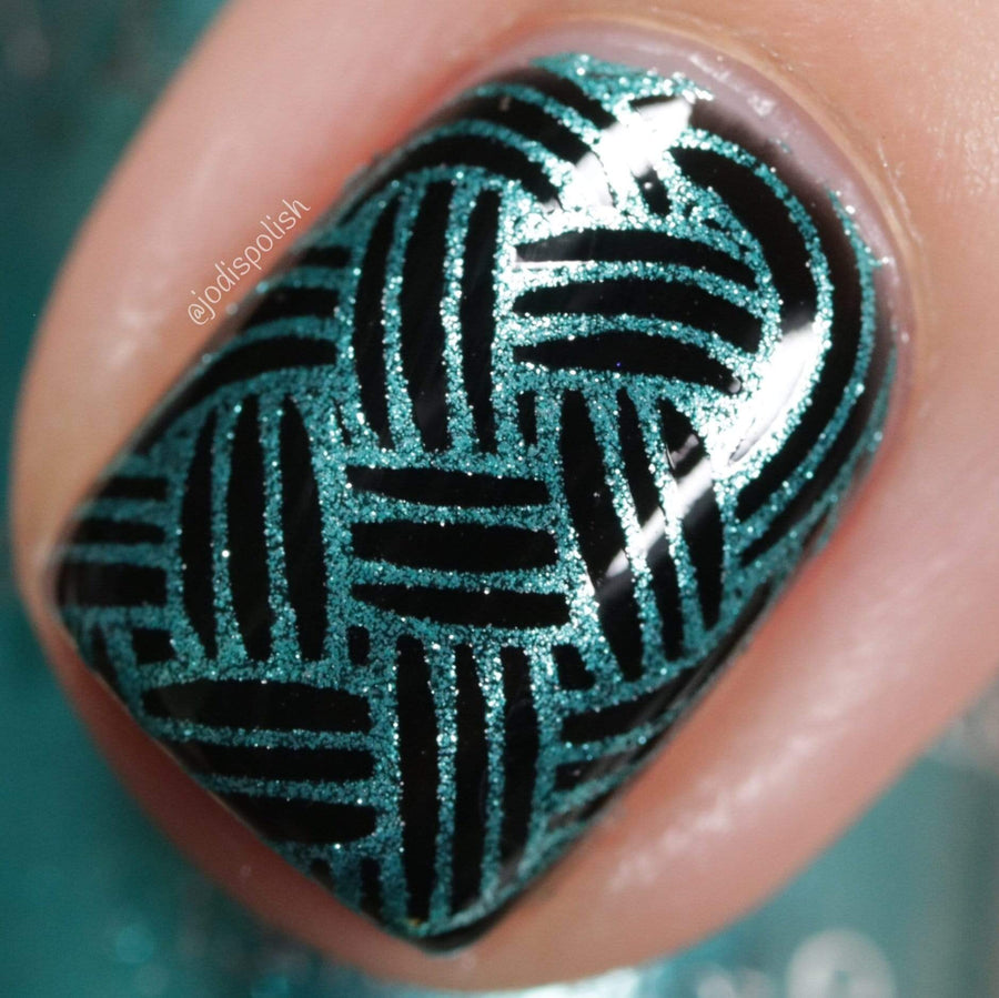 A manicured hand made with Metallic Teal Stamping Polish from Soiree All Day collection Sequins (B320).