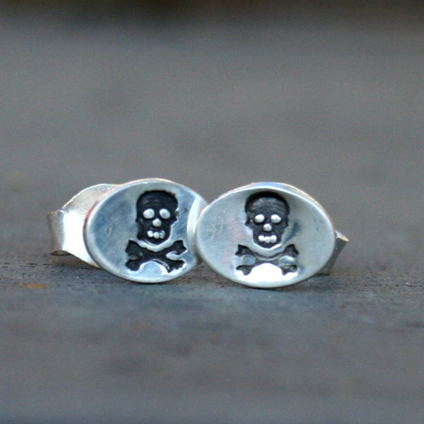 Sterling Silver Oval Post Earrings - Skull and Crossbones