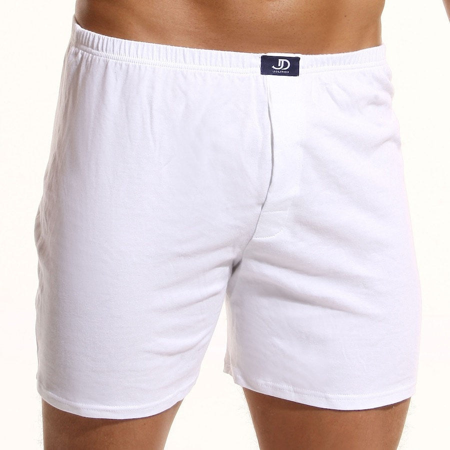 Long Boxers N3. White men's lingerie long boxer shorts with a branded navy label on a medium waist white fabric-over-the-elastic belt.