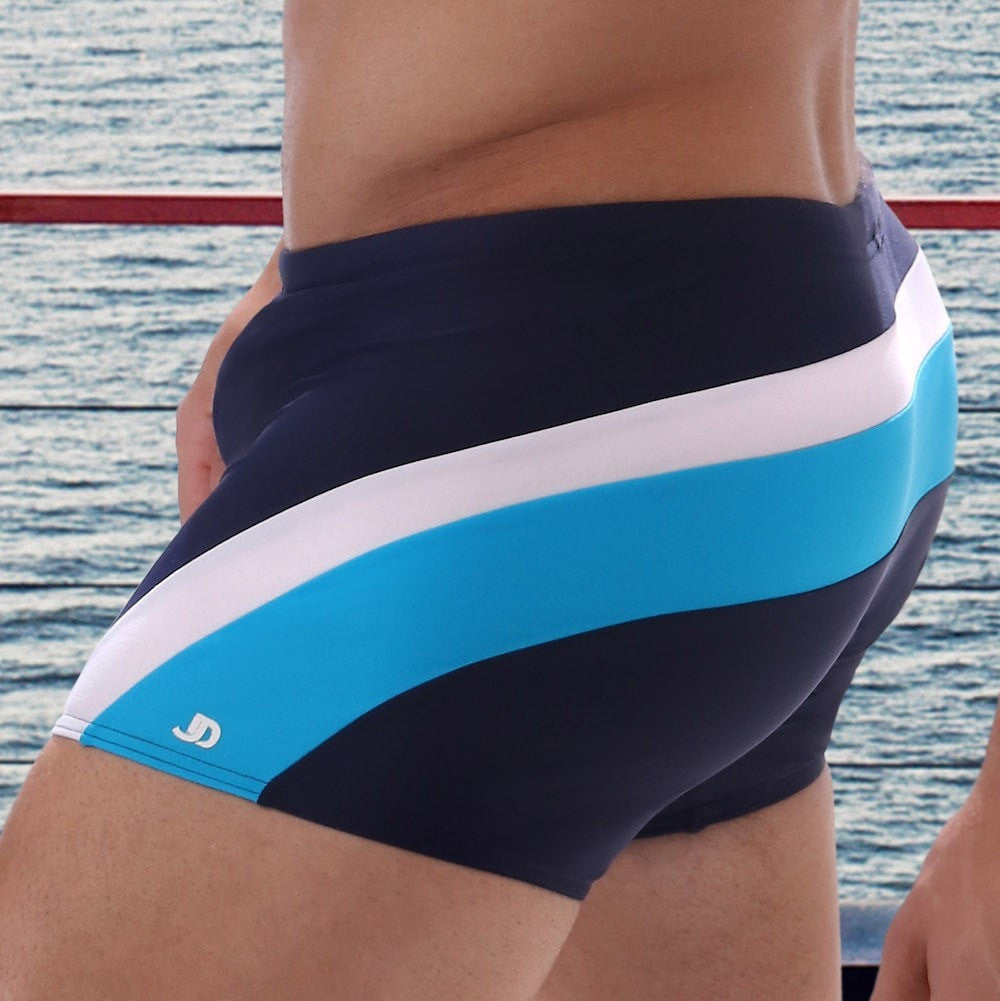 Men's swim/beach tight navy boxers with a sporty design of white and azure stripes going round the back side from one thigh to the other