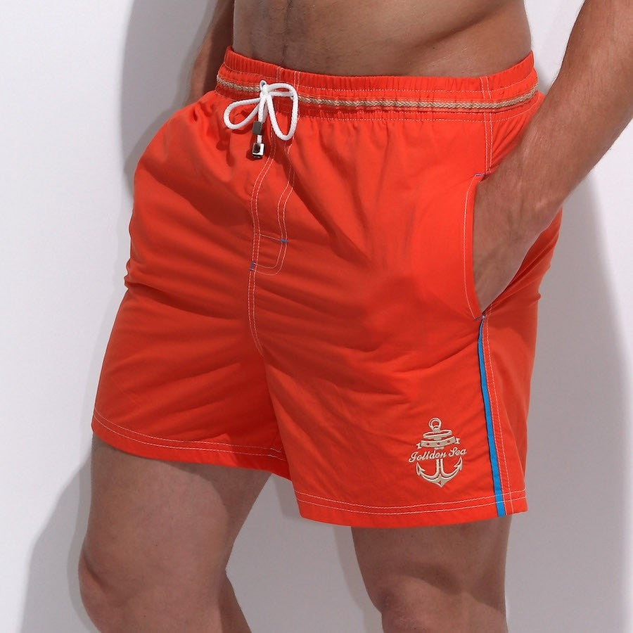 orange men's swim/beachwear loose trunks with a drawstring waist belt and side pockets.
