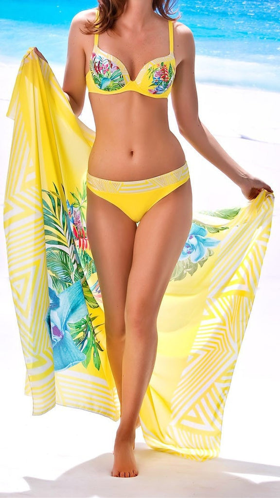 Women's beachwear pareo with a floral design on a vivid yellow background perfect for a windy day or evening on the beach. Material: 100%PES.