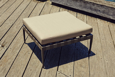 Shown in Aluminum Asteroid Frame, Taupe strapping and Sunbrella Taupe fabric