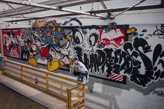 "Behind Artist 2Shae's ""Pill Head"" Mural at The Hundreds Homebase"