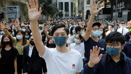How the Face Mask Became an Environmental, Political, and Stylistic Staple