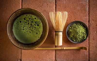 Ceremonial Matcha Tea Set including a chawan, whisk, matcha green tea powder, and a spoon