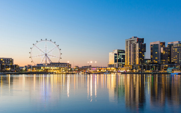 Panoramic image of the docklands waterfront area of Melbourne at night; Shutterstock ID 213986041