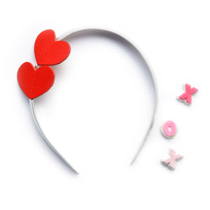 This sweet red heart headband will look adorable on the girl that you love.