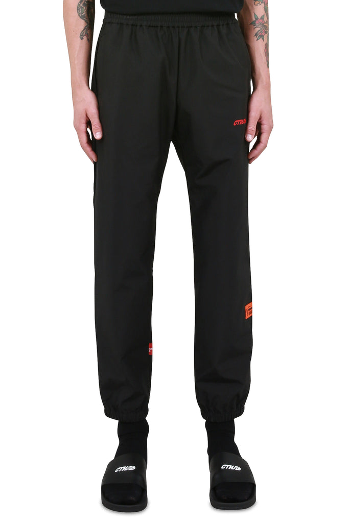HERON PRESTON: Elastic Nylon Tape Pants - Black | LESSONS