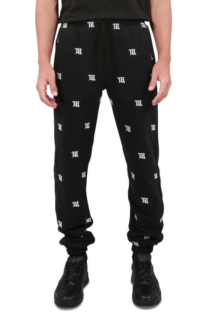 MISBHV: Embroidered Monogram Sweatpants - Washed Black | LESSONS