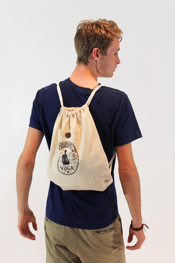 Yoga Stamp Drawstring Cotton Canvas Backpack in Cream - Koia Collective
