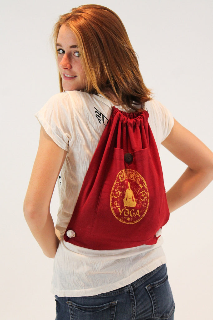 Yoga Stamp Drawstring Cotton Canvas Backpack in Red - Koia Collective
