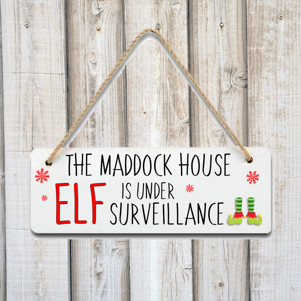 The Family House Is Under Elf Surveillance Personalised Christmas Plaque Sign - Mugged Write Off