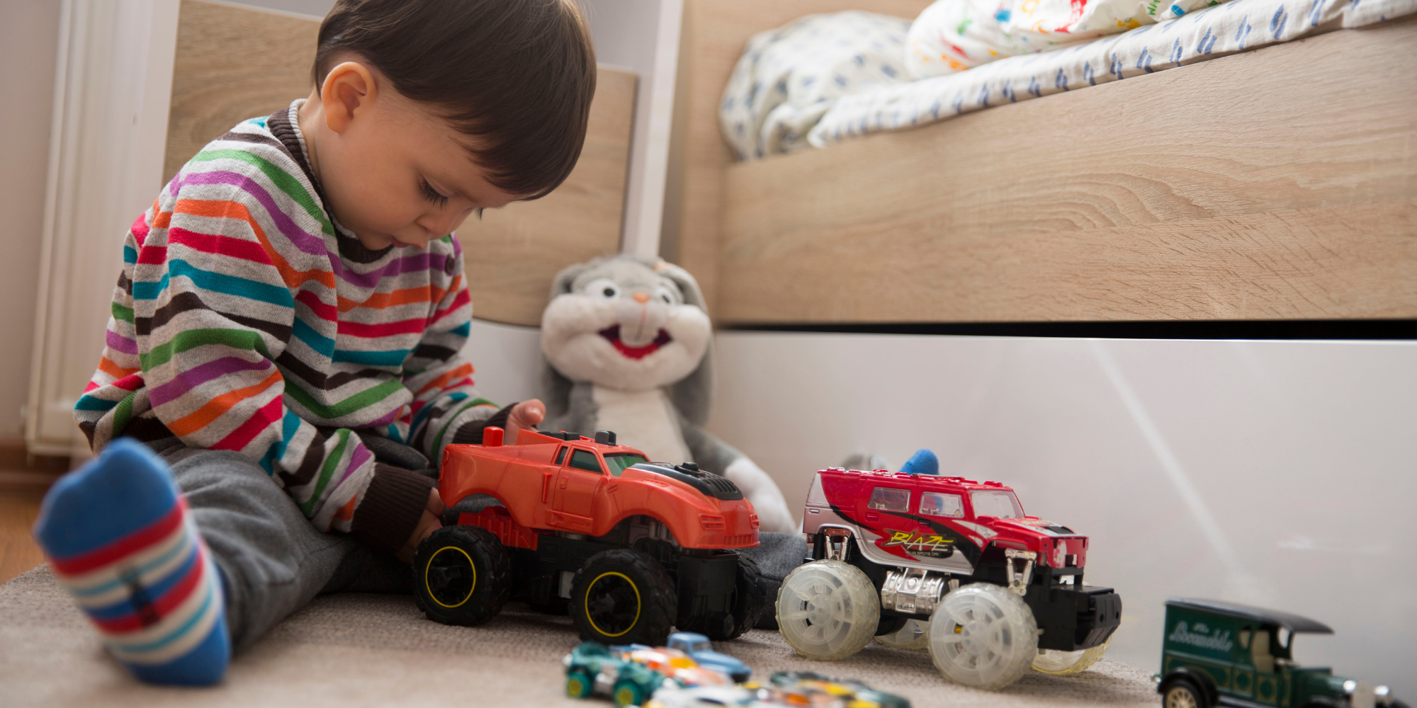 Little boy playing with his toys