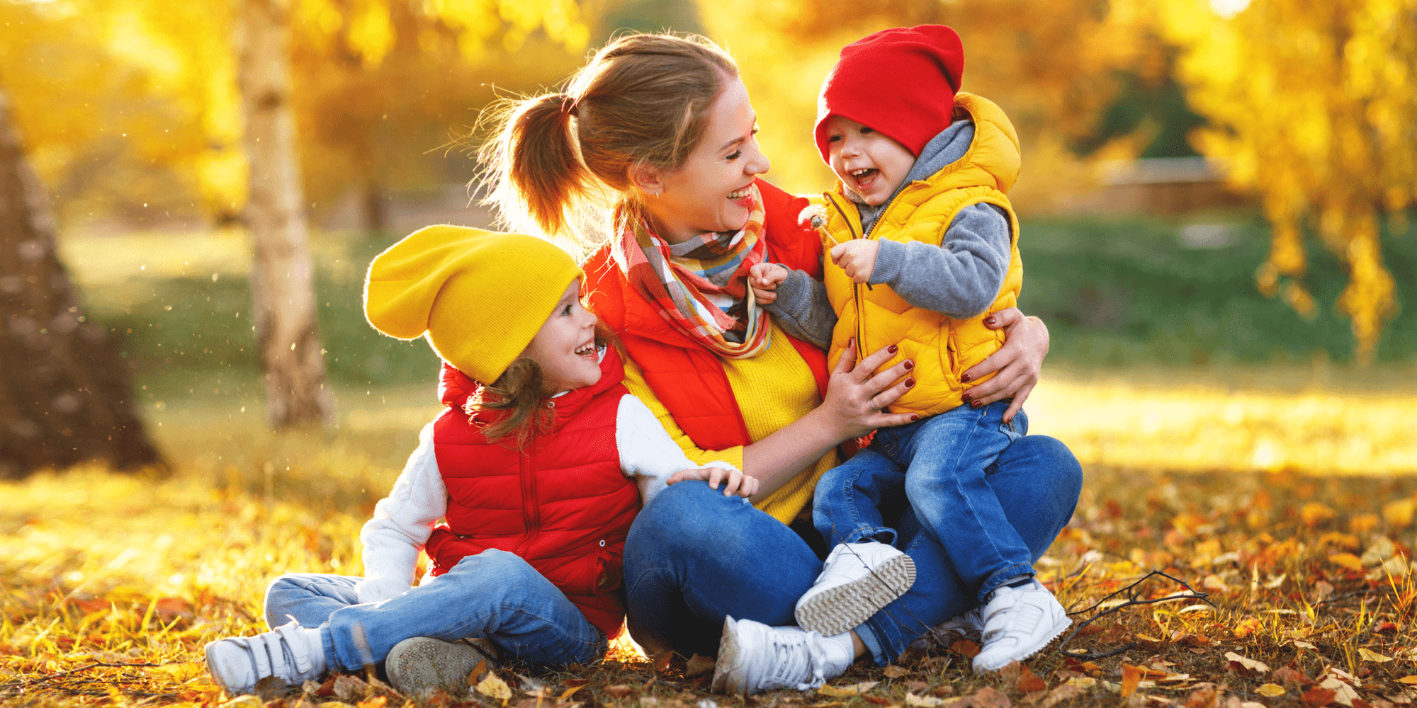 Mum and children playing in the Autumn outdoors