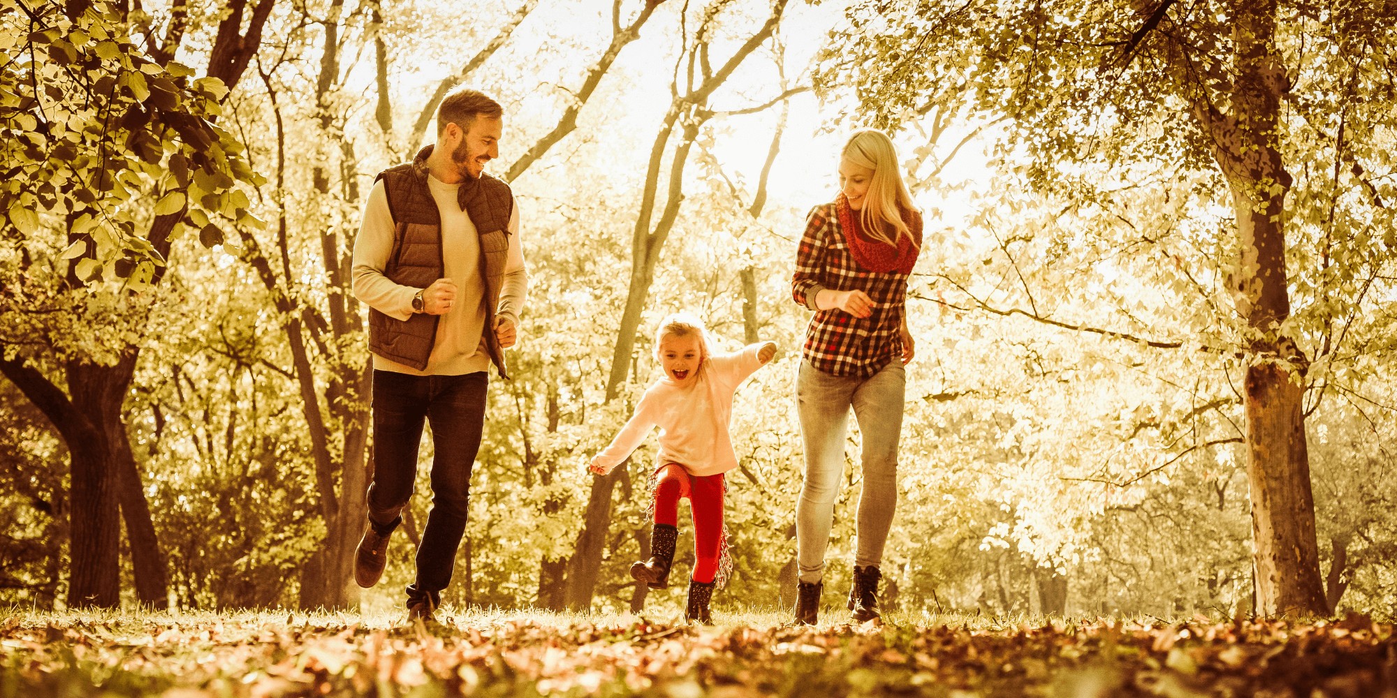 Family playing in the woodland