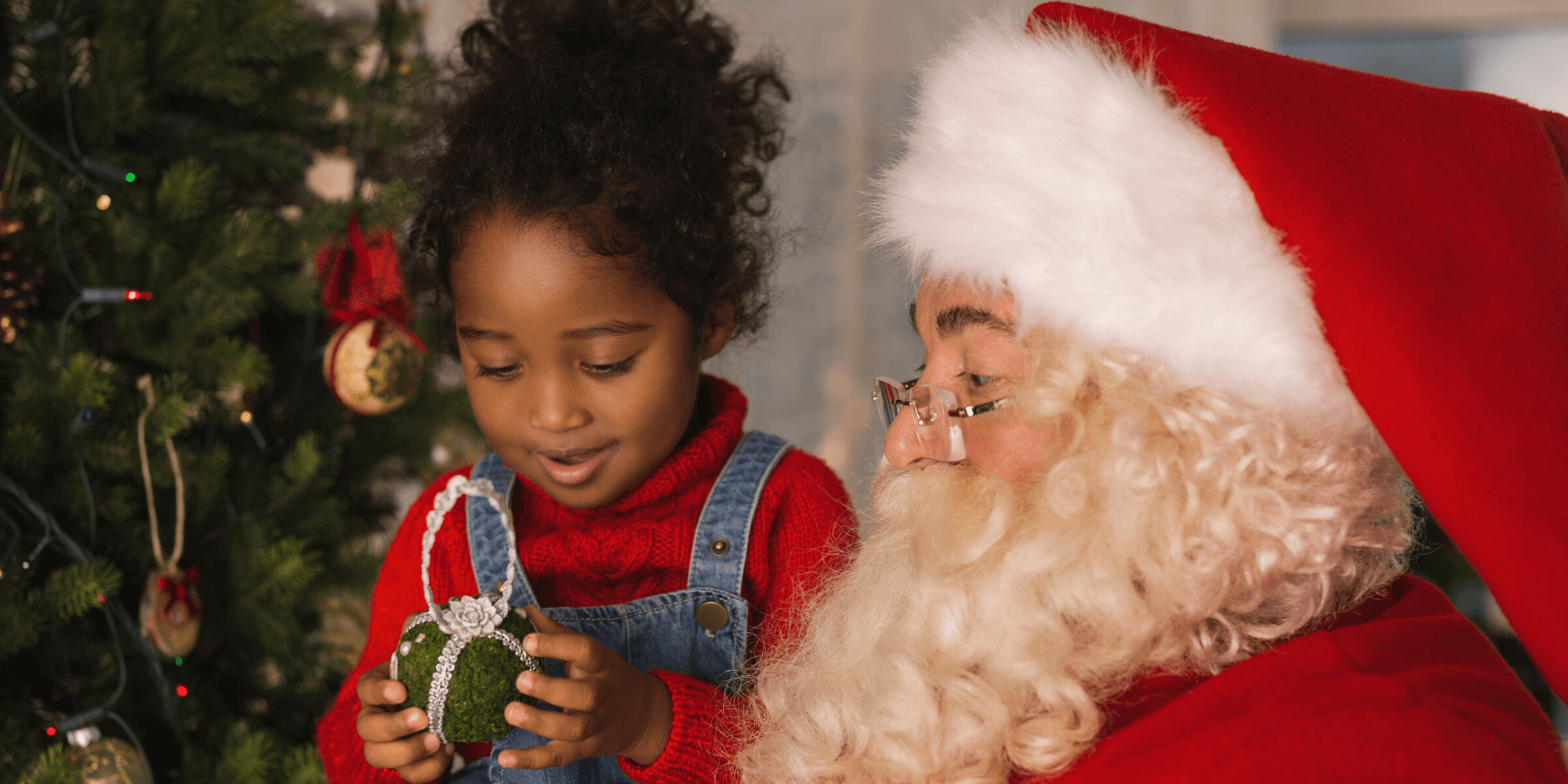 Little girl with Santa on Christmas Day