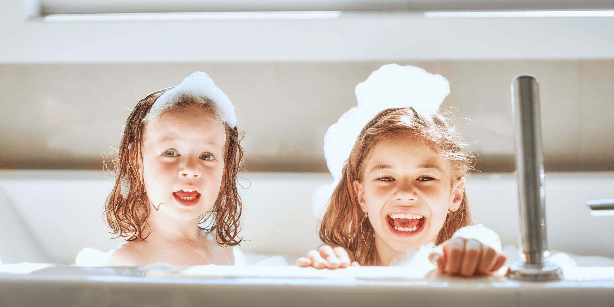 Little girls playing during bath time