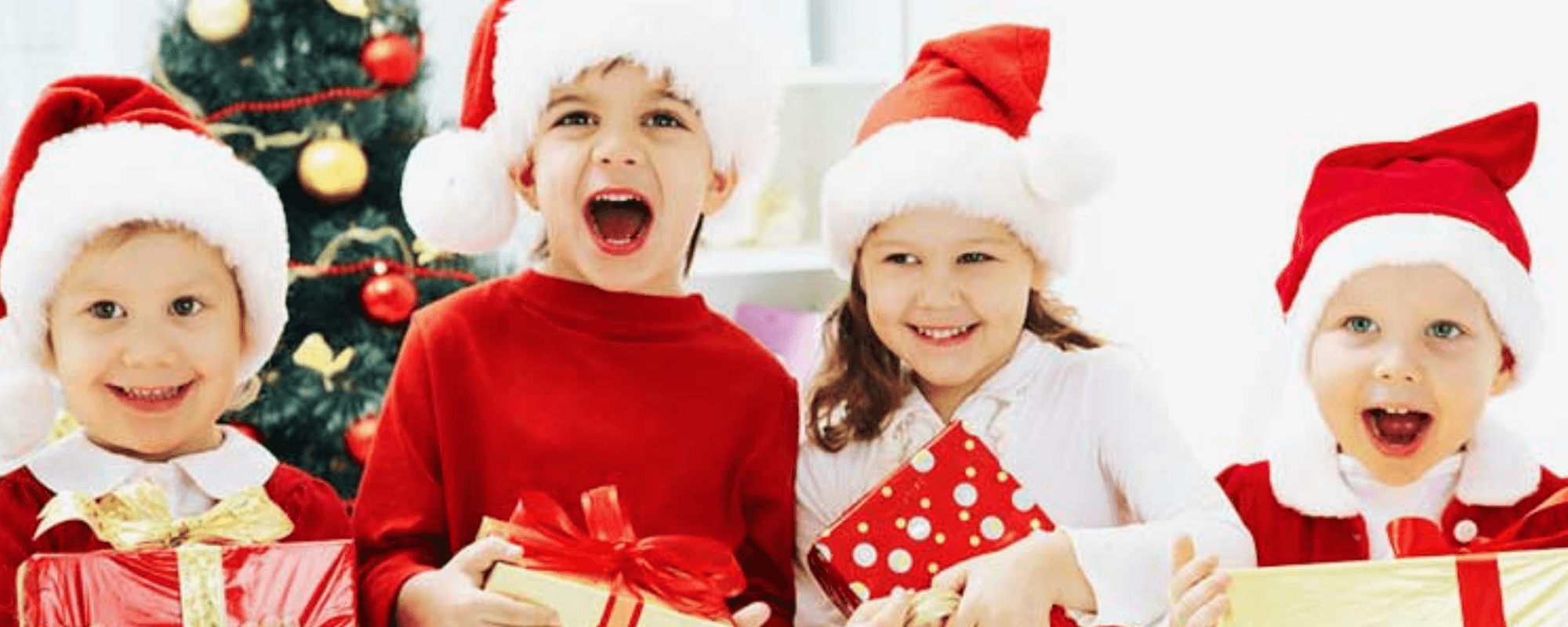 children happy at opening Christmas presents