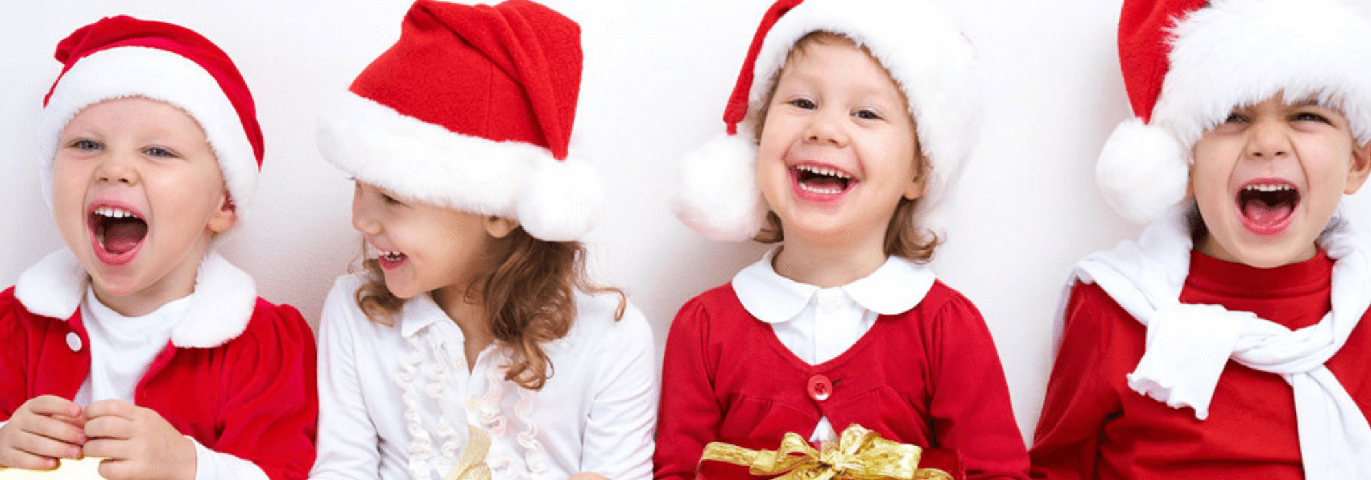 children in Christmas outfits