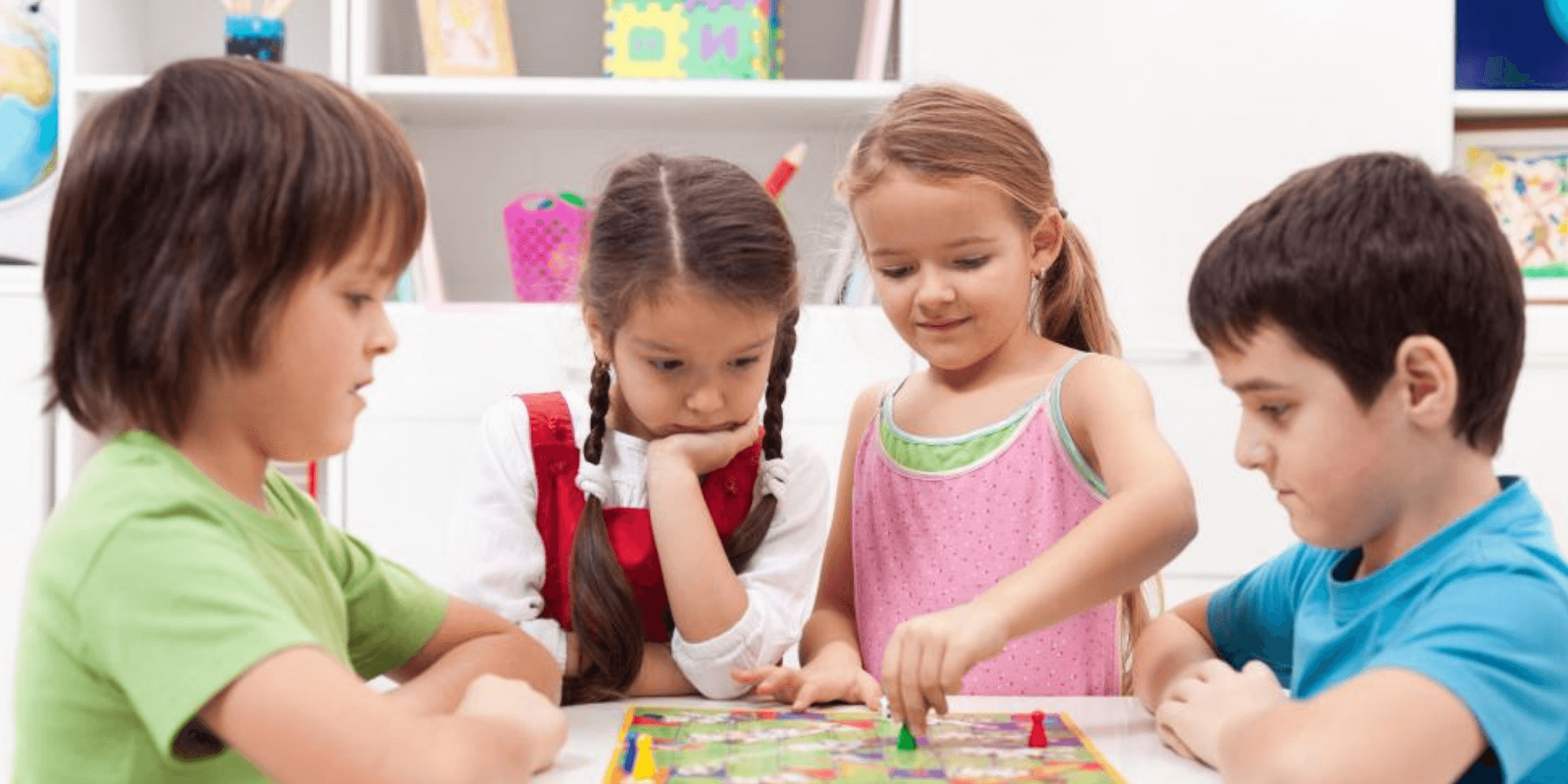 children playing board games