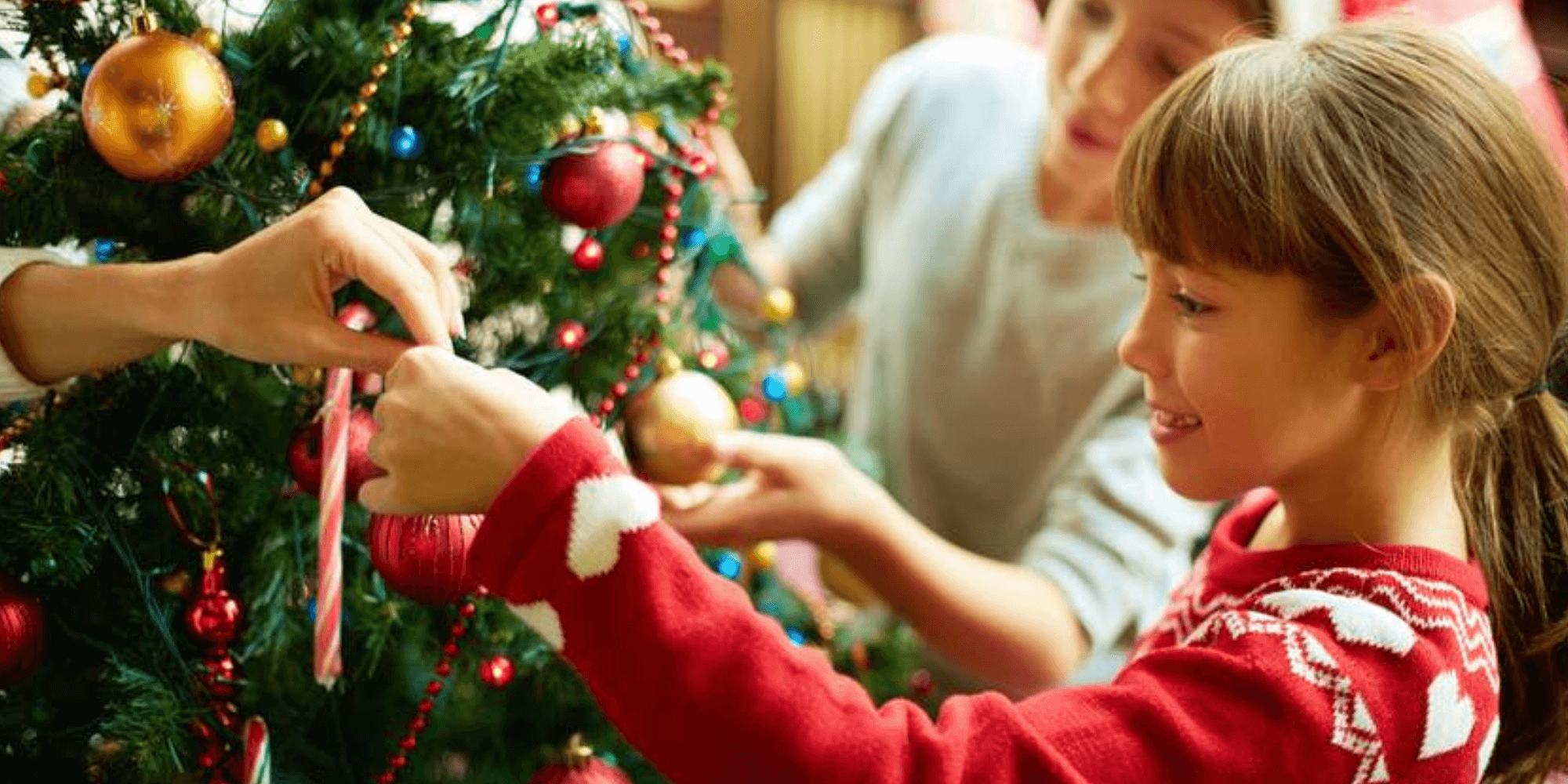 children putting decorations on the tree