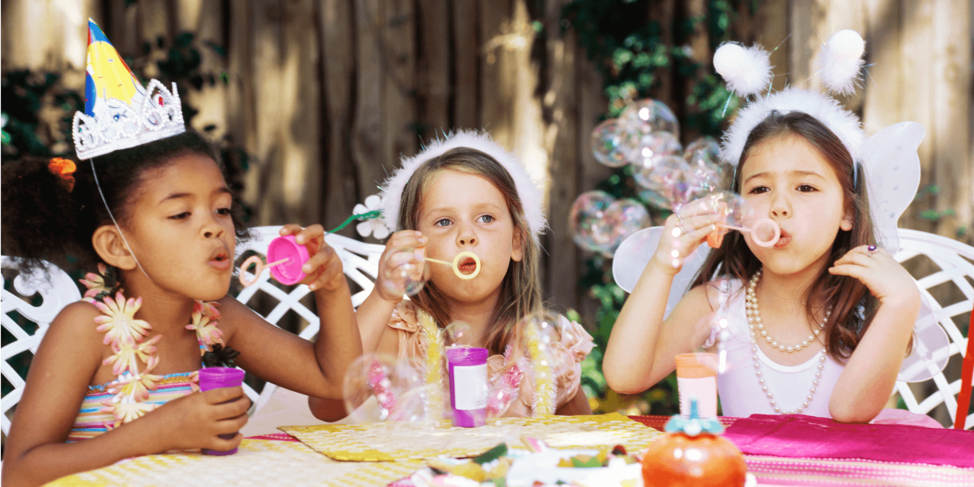 Girls blowing bubbles at a birthday party