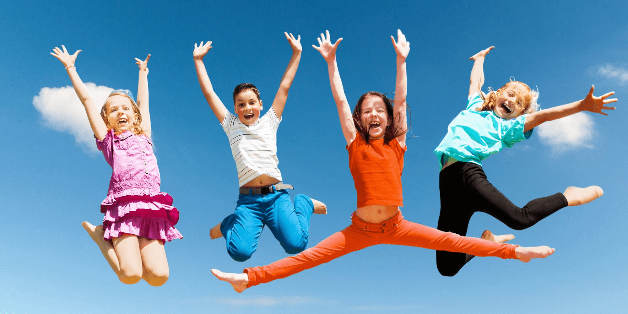 Group of children jumping up in happiness