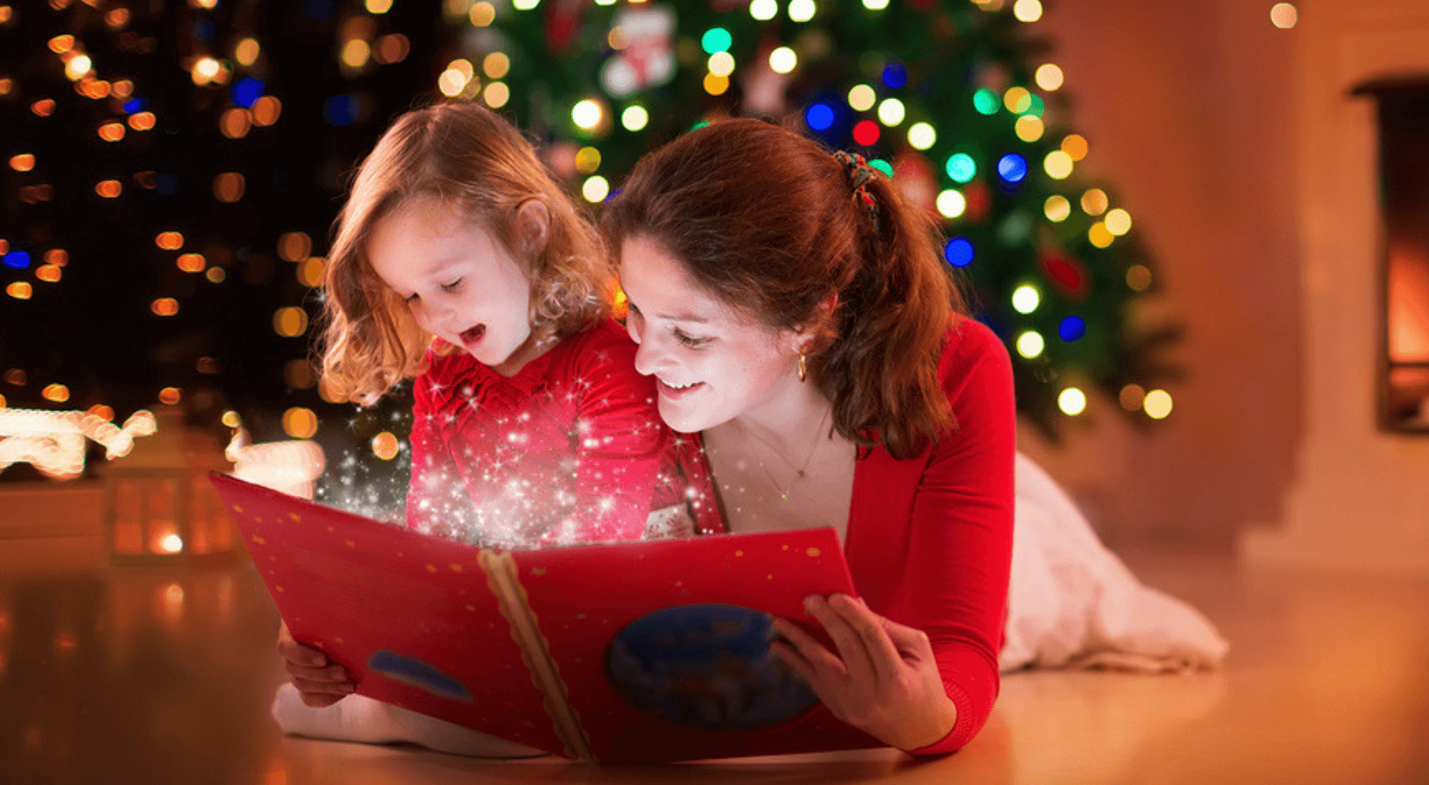 mum and little girl reading a christmas book