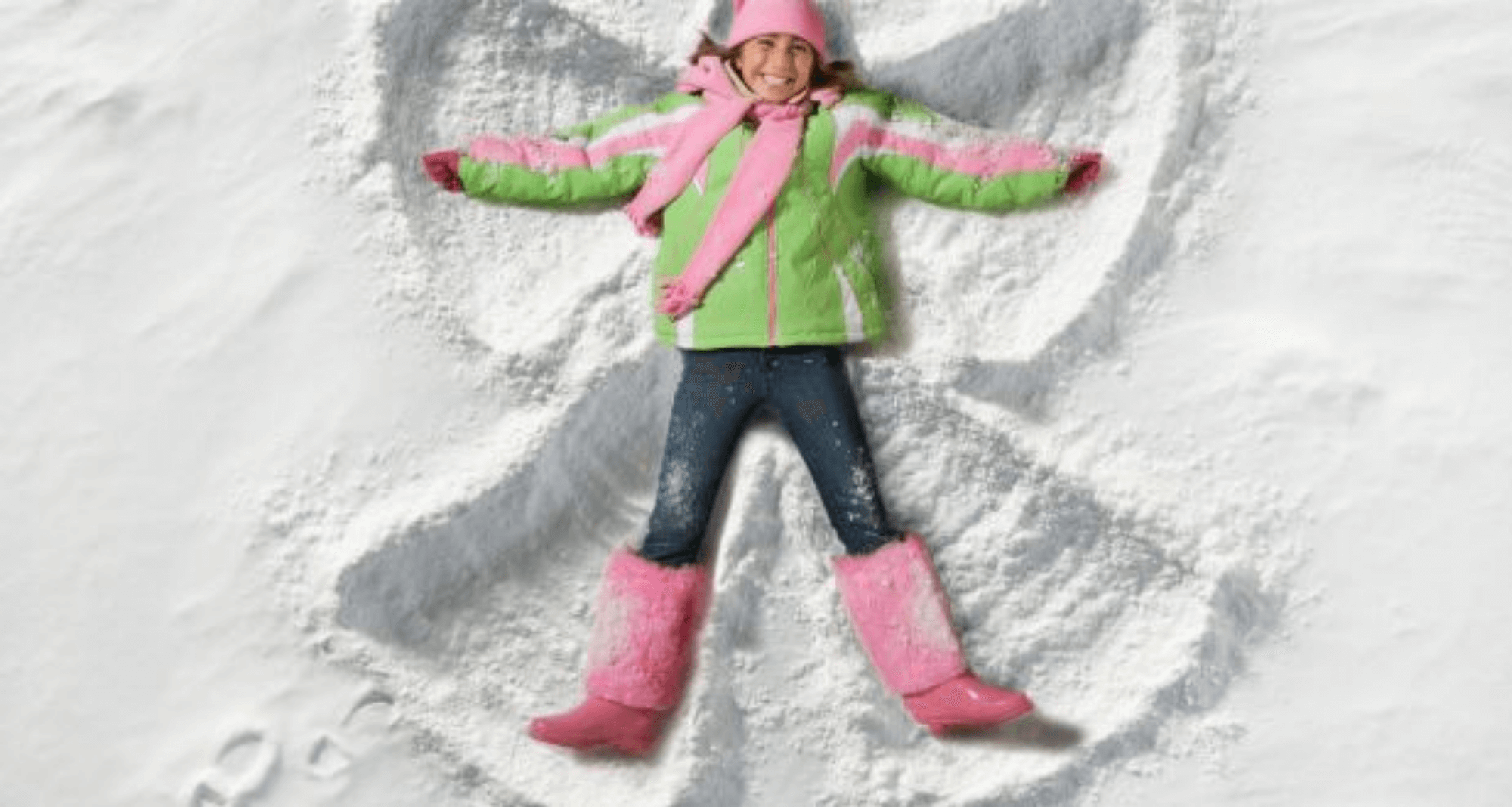 girl making snow angles