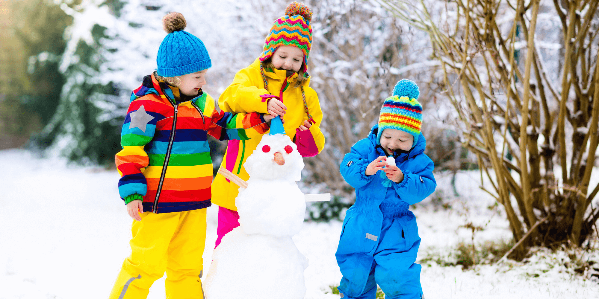3 little children building a snowman
