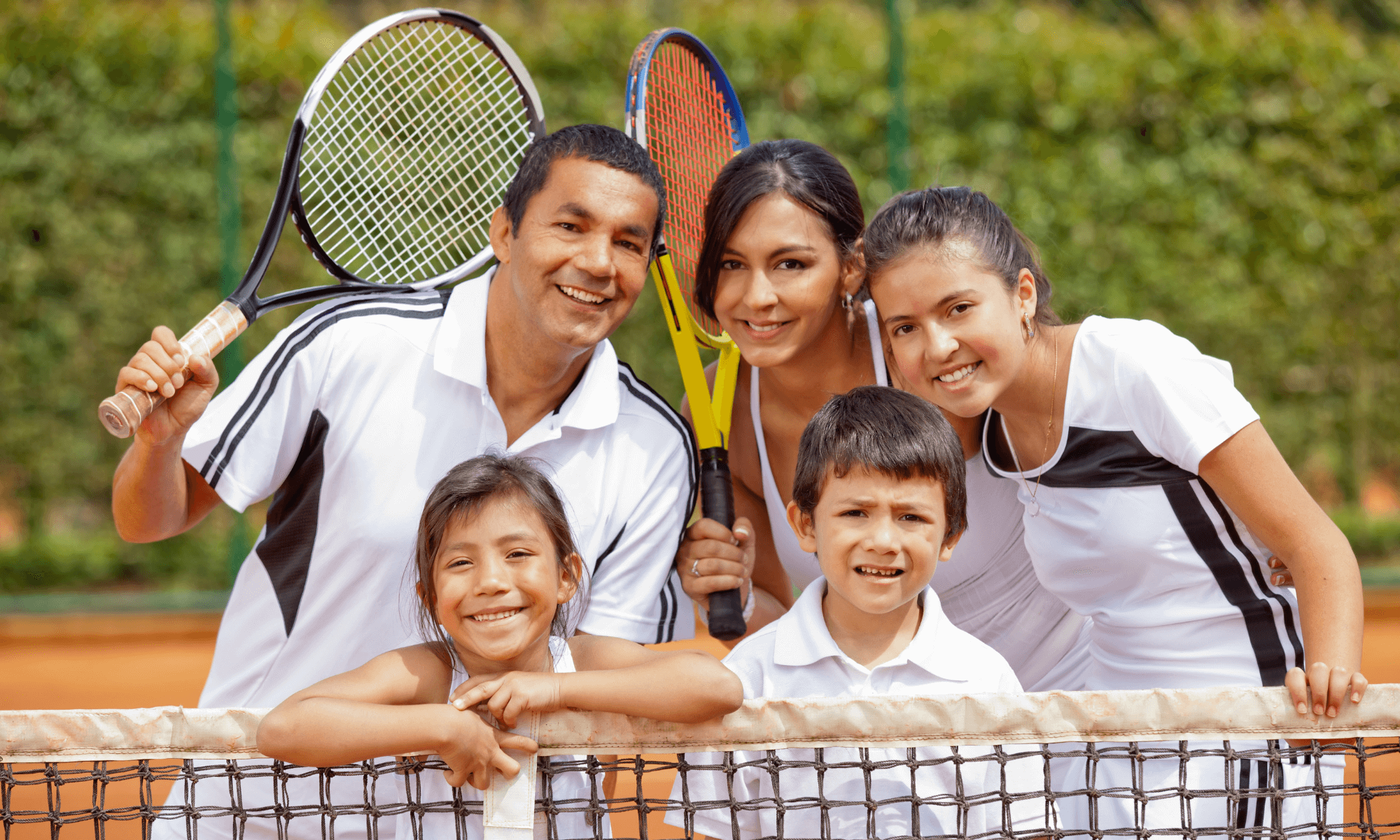 a family playing tennis together