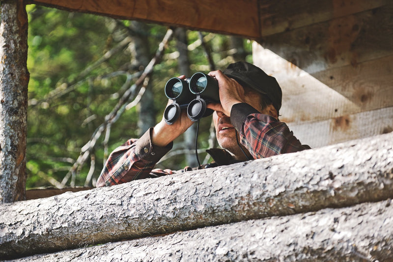 Man with binoculars from viewing platform