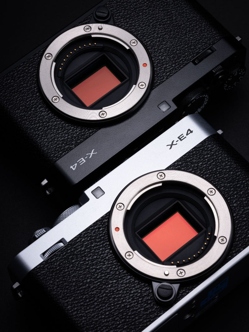 Fujifilm X-E4 Camera in black and black & silver without lenses