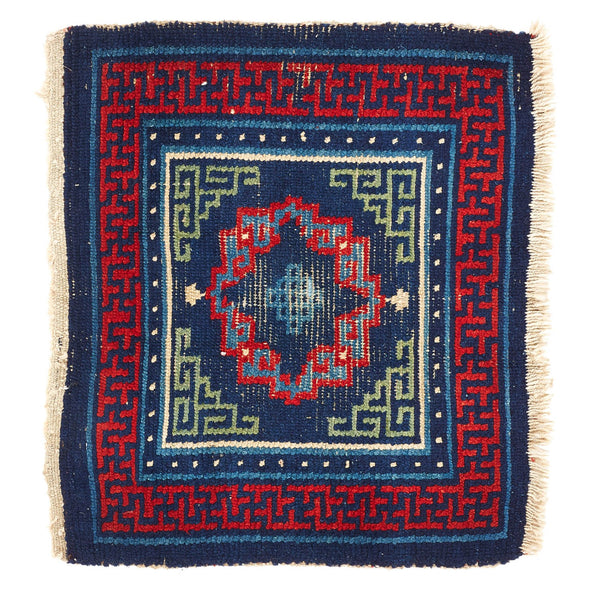 wool mat with blue red and yellow design embroidery