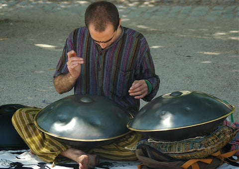 man with two large steel tongue drums playing