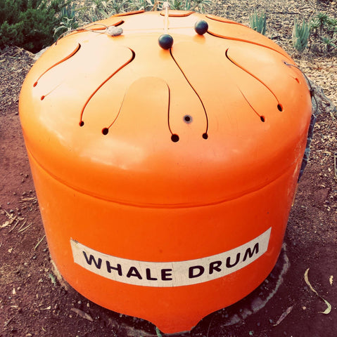 large orange tongue drum whale drum label stuck on its surface