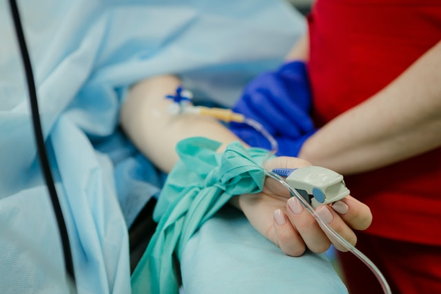 close up on hand with medical contraptions placed iv tubes