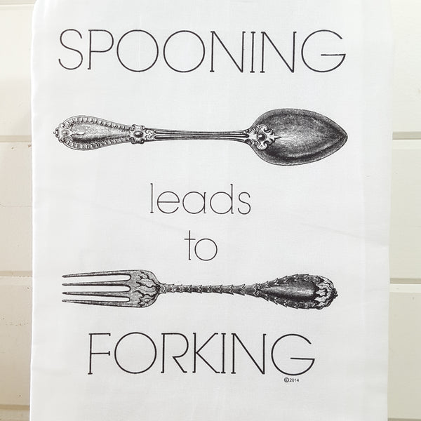 Front of spooning leads to forking utensil towel