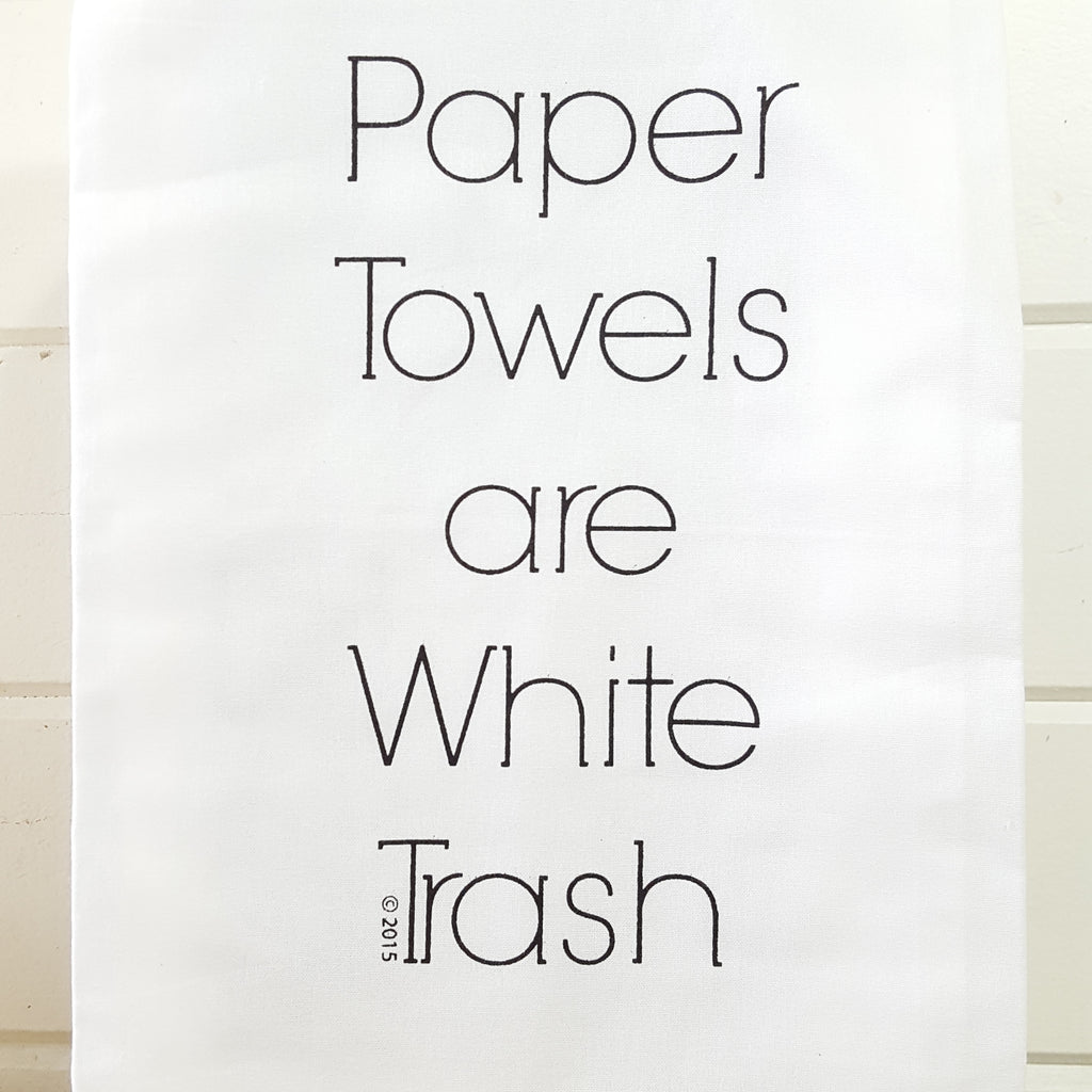 front of paper towel are white trash towel